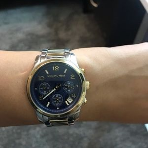 Michael Kors two tone watch with navy blue face